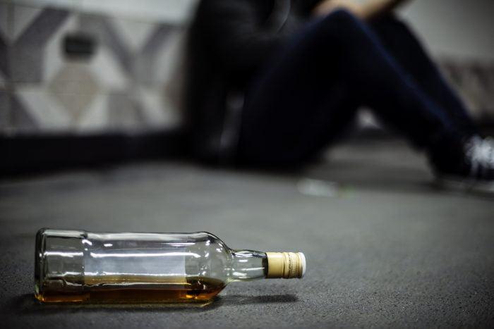 Liquor Alcohol Bottle Lying on The Floor